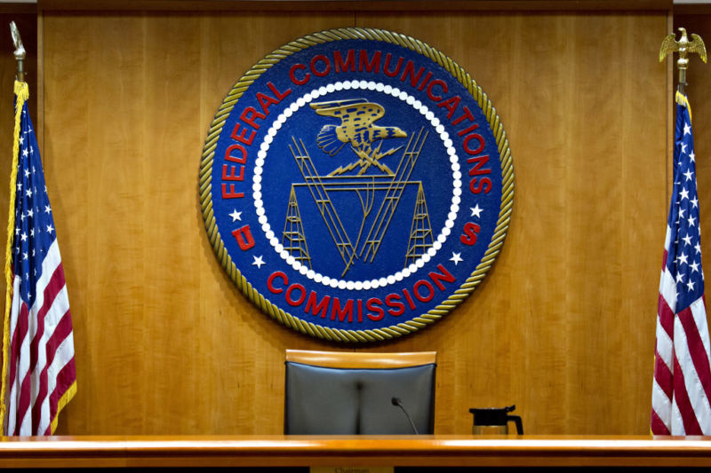 The Federal Communications Commission (FCC) seal hangs inside a meeting room at the headquarters ahead of a open commission meeting in Washington, D.C., U.S., on Thursday, Dec. 14, 2017. The FCC is slated to vote to roll back a 2015 utility-style classification of broadband and a raft of related net neutrality rules, including bans on broadband providers blocking and slowing lawful internet traffic on its way to consumers. Photographer: Andrew Harrer/Bloomberg via Getty Images
